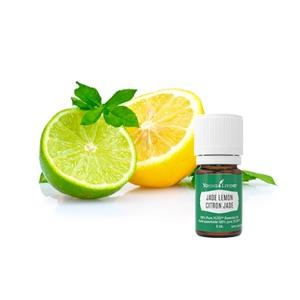 bottle of jade lemon essential oil beside lime and lemon halves